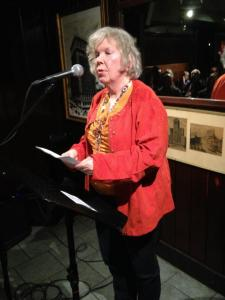 Julie reading at the Nitty Gritty Slam