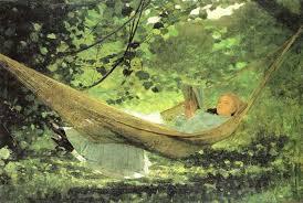 Woman reading summer hammock