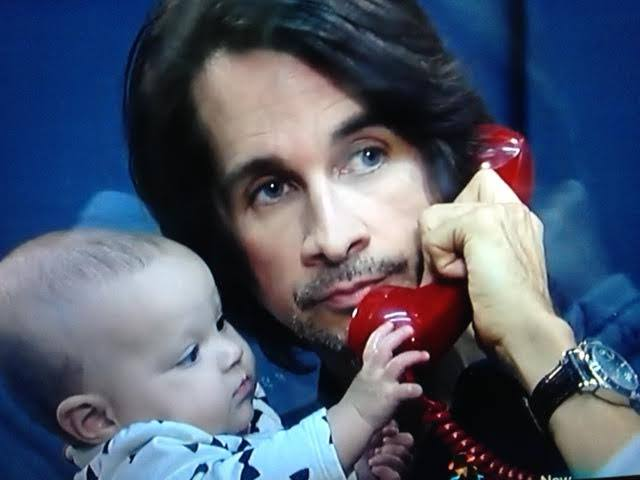 Michael E with baby and red phone 1-27-15